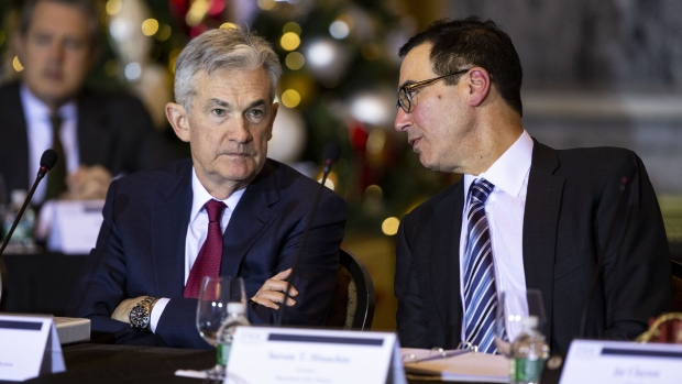 Steven Mnuchin, U.S. Treasury secretary, right, speaks with Jerome Powell, chairman of the U.S. Fede