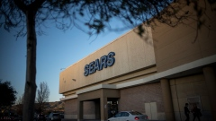 A vehicle sits parked outside of a Sears Holdings Corp. store in San Bruno, California, U.S., on Friday, Dec. 28, 2018. Sears got another chance at survival after Chairman Eddie Lampert put together a last-minute, last-ditch bid to buy the retailer out of bankruptcy.