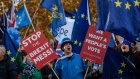 Anti-Brexit campaigners shout slogans outside the Houses of Parliament in the Westminster district of London, U.K., on Monday, Nov. 19, 2018. Ever since Prime Minister Theresa May announced her Brexit deal, she has sought to go over the heads of her critics and appeal directly to voters to back her plan.