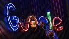 The Google Inc. logo hangs illuminated at the company's exhibition stand at the Dmexco digital marketing conference in Cologne, Germany, on Wednesday, Sept. 14, 2016.