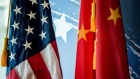 U.S. and China flags.