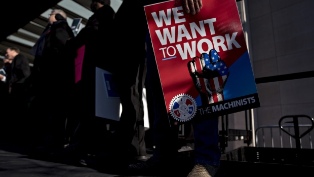 "A demonstrator holds a ""We Want To Work"" sign during a rally with union members and federal employees to end the partial government shutdown outside the American Federation of Labor & Congress of Industrial Organizations headquarters in Washington, D.C. on Jan. 10, 2019."