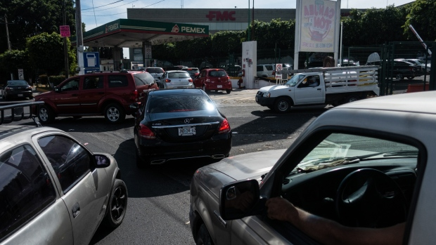 Vehicles wait in line to enter a Pemex gas station in Zapopan, Mexico on Jan. 7. Photographer: Cesar Rodriguez/Bloomberg