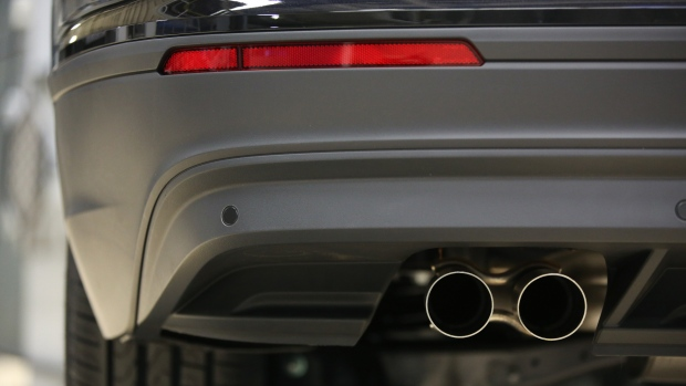Exhaust pipes hang from the underside of a VW Tiguan automobile at the end of the production line at the Volkswagen Group Rus OOO plant in Kaluga, Russia, on Tuesday, Sept. 19, 2017. VW's return from debt market exile following its 2015 diesel emissions scandal has helped propel European bond sales past 1 trillion euros ($1.2 trillion) one month earlier than in 2016.