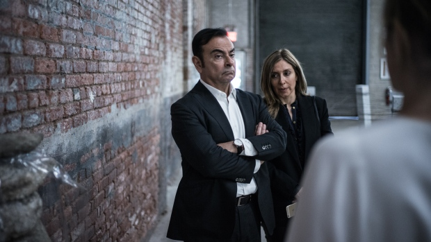 Carlos Ghosn, chairman of Renault SAS, Nissan Motor Co., and Mitsubishi Motors Corp., left, and his wife Carole Nahas view artwork at the DIA Art Foundation in the Chelsea neighborhood of New York, U.S., on Saturday, May 6, 2017. Ghosn's celebrated specialty is resuscitating companies from near death. He first did it in the mid-1990s at Renault, where he slashed costs, and pulled the company back into profitability. Photographer: Misha Friedman/Bloomberg