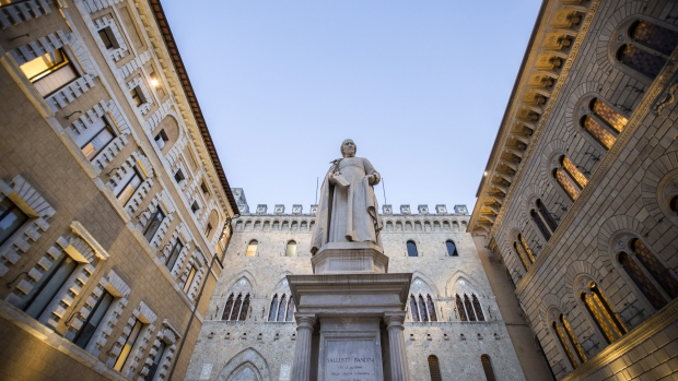 The statue of Sallustio Bandini, an economist and politician, stands in Piazza Salimbeni in front of the Monte dei Paschi di Siena SpA bank headquarters in Siena, Italy, on Friday, Dec. 16, 2016. The bank will begin taking orders for shares Monday as it aims to complete raising 5 billion euros ($5.2 billion) by the end of the year to avoid a rescue by the Italian government.