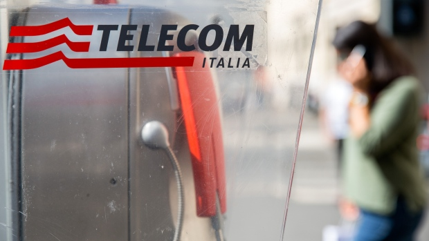 A logo sits on a fixed-line public telephone booth, operated byTelecom Italia SpA, in Rome, Italy, on Monday Sept. 25, 2017. Telecom Italia is considering another management shuffle that may see an Italian returning to a senior role at the country's biggest phone carrier in a bid to head off punitive action by regulators in the country, people familiar with the matter said.