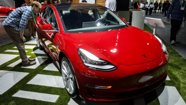 The Tesla Inc. Model 3 vehicle is displayed during AutoMobility LA ahead of the Los Angeles Auto Show in Los Angeles, California, U.S., on Wednesday, Nov. 29, 2017.  Photographer: Patrick T. Fallon/Bloomberg