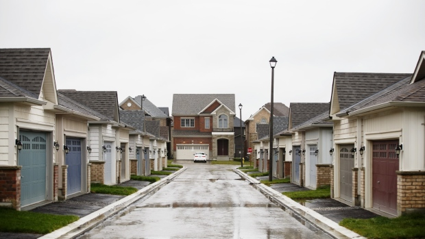 New homes stand in East Gwillimbury, Ontario, Canada, on Friday, Nov. 2, 2018. STCA Canada is scheduled to release new housing price figures on Dec. 13.