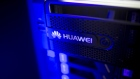 The Huawei Technologies Co. logo is displayed on a storage system inside an exhibition hall at the company's campus in the Longgang district of Shenzhen, China, on Wednesday, Aug. 6, 2014.