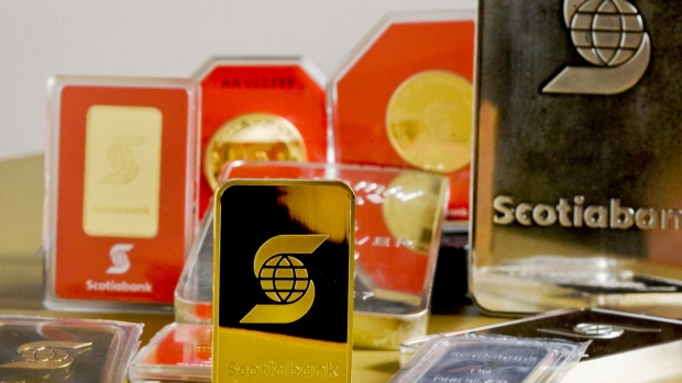Gold bars on display during the inauguration of the ScotiaMocatta eStore in 2009. Photographer: Norm Betts/Bloomberg