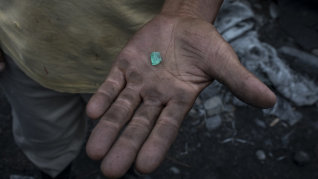 An independent miner, know as a guaquero, holds an emerald found outside a mine in Muzo, Colombia, on Friday, Aug. 4, 2017. Colombia is the world's largest producer of emeralds. The Town of Muzo is known as the world capital of emeralds because its mines contain the highest quality emerald gems.