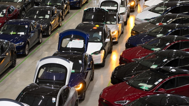 A line of new Tesla Model X sports utility vehicles (SUV), center, sit with Tesla Model S automobiles following assembly for the European market at the Tesla Motors Inc. factory in Tilburg, Netherlands.