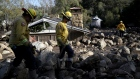 MONTECITO, CA - JANUARY 10: Firefighters search for people trapped in mudslide debris on January 10, 2018 in Montecito, California. 15 people have died and hundreds are still stranded after massive mudslides crashed through Montecito, California early Tuesday morning. (Photo by Justin Sullivan/Getty Images)
