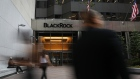 Pedestrians walk past BlackRock Inc. headquarters in New York, U.S, on Wednesday, June 11, 2018. BlackRock Inc. is scheduled to release earnings figures on July 16.