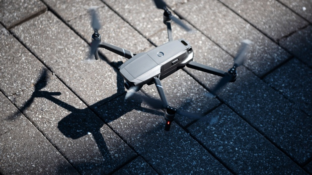 A SZ DJI Technology Co. Mavic 2 Zoom drone lands at the Brooklyn Navy Yard in the Brooklyn Borough of New York, U.S., on Thursday, Aug. 23, 2018. DJI introduced two additions to the Mavic series: the Mavic 2 Pro, with an integrated Hasselblad camera, and the Mavic 2 Zoom, a foldable consumer drone with optical zoom capability.