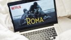 "The home screen for the Netflix Inc. original movie ""Roma"" is seen on an Apple Inc. laptop computer in this arranged photograph taken in the Brooklyn Borough of New York, U.S., on Sunday, Jan. 13, 2019. Netflix is scheduled to release earnings on January 17."