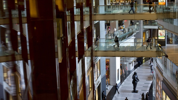 People walk through The Shops at Columbus Circle mall in New York, U.S.
