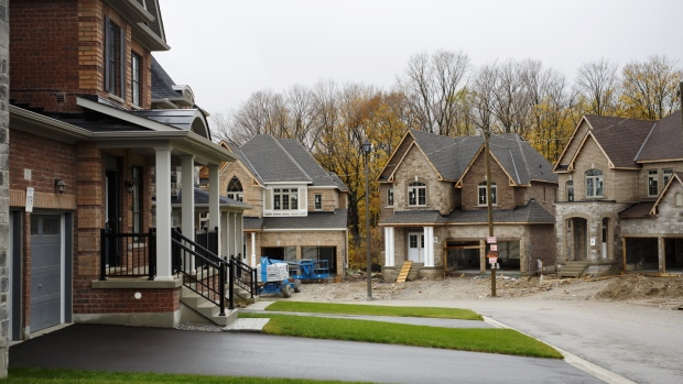 Homes for sale stand in East Gwillimbury, Ontario, Canada, on Friday, Nov. 2, 2018. STCA Canada is scheduled to release new housing price figures on Dec. 13. Photographer: Cole Burston/Bloomberg