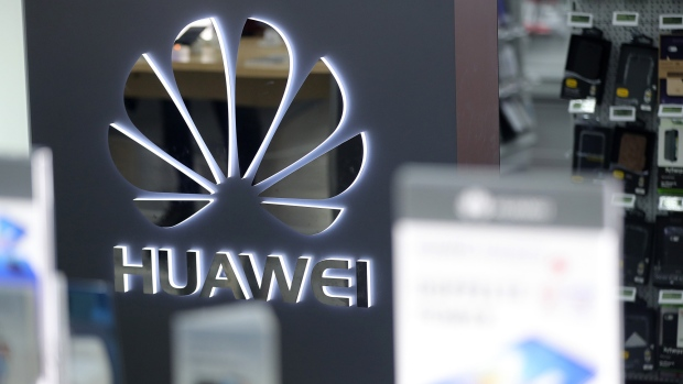A Huawei Technologies Co. logo sits on display in a store
