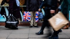 A pedestrian holds shopping bags branded with the Union Flag, also know as Union Jack, on Oxford Street in central London, U.K., on Tuesday, Dec. 4, 2018. U.K. consumer spending growth slowed in November as concerns about Brexit prompted households to become more cautious with their cash.