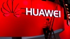 Signage for Huawei Technologies Co. logo is displayed outside a store in Shanghai, China, on Tuesday, Jan. 29, 2019.