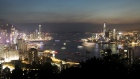 Light trails left by passing ships crossing the Victoria Harbor are seen as buildings stand illuminated on Hong Kong island, left, and in the Kowloon area in Hong Kong, China, on Tuesday, May 29, 2018. The U.S. dethroned Hong Kong to retake first place among the world's most competitive economies, thanks to faster economic growth and a supportive atmosphere for scientific and technological innovation, according to annual rankings by the Switzerland-based IMD World Competitiveness Center.