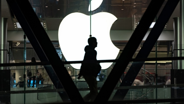 The Apple Inc. logo is displayed at one of the company's stores in Hong Kong, China, on Thursday, Jan. 3, 2019. Apple cut its revenue outlook for the first time in almost two decades citing weaker demand in China, triggering a slump for Asian suppliers and a wave of lower price targets on Wall Street.