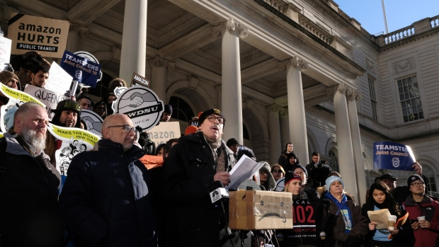George Miranda, vice president of the International Brotherhood of Teamsters, center, speaks during a protest against Amazon outside of City Hall in the Long Island City neighborhood in the Queens borough of New York on Jan. 30, 2019.