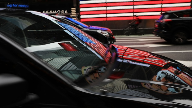 A ride hailing vehicle moves through traffic in Manhattan on July 30, 2018 in New York City.