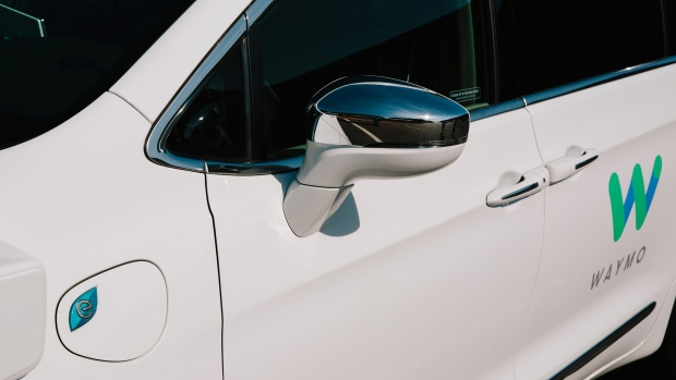 The side mirror of a Waymo LLC Chrysler Pacifica autonomous vehicle