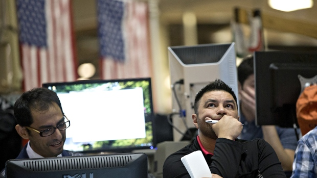 Traders work in the Cboe Volatility Index pit on the floor of the Cboe Global Markets Inc. building in Chicago.