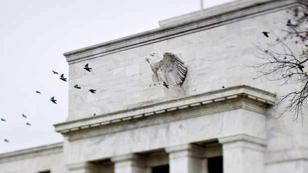 Birds fly past the Marriner S. Eccles Federal Reserve Board building in Washington, D.C., U.S.
