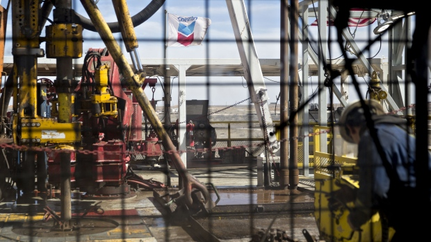 A chevron corp flag flies on the drilling floor of a nabors industries ltd drill rig in the permian basin near midland texas u s on thursday march 1 2018