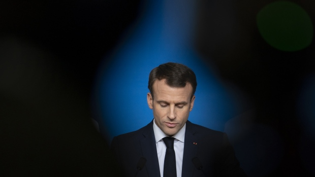 Emmanuel Macron, France's president, pauses during a news conference at a European Union (EU) leaders summit in Brussels, Belgium, on Friday, Dec. 14, 2018. European leaders rebuffed U.K. Prime Minister Theresa May's pleas to help her sell the Brexit agreement to a skeptical U.K. Parliament, toughening their stance as they stepped up planning for a chaotic no-deal divorce. Photographer: Jasper Juinen/Bloomberg