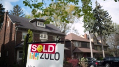 A sold sign is shown in front of west-end Toronto homes Sunday, May 14, 2017.