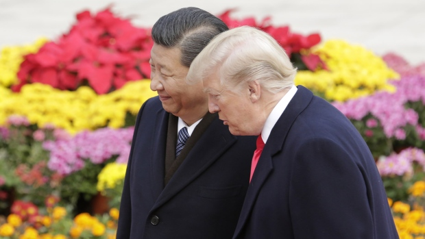U.S. President Donald Trump, right, speaks with Xi Jinping, China's president, during a welcome ceremony outside the Great Hall of the People in Beijing on Nov. 9, 2017.