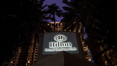 A Hilton Worldwide Holdings Inc. Grand Vacations Club hotel stands at night in Las Vegas, Nevada, U.S., on Wednesday, Feb. 24, 2016.