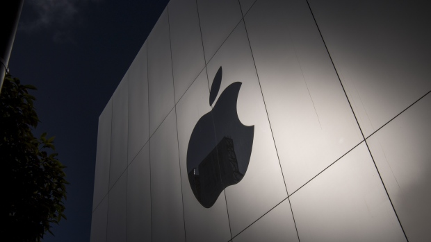 The Apple Inc. logo is seen on the front of the store during the sales launch of the Apple Inc. iPhone 8 smartphone, Apple watch series 3 device, and Apple TV 4K in San Francisco, California, U.S., on Friday, Sept. 22, 2017.