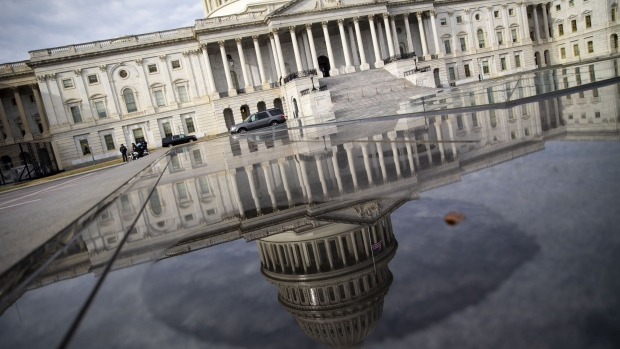 The U.S. Capitol building is reflected in a pool in Washington, D.C.