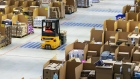 An employee uses a forklift truck to move boxes around an Amazon.com Inc. fulfilment center in Koblenz, Germany, on Friday, Nov. 23, 2018.