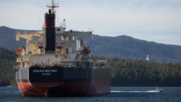 The Ocean Destiny bulk carrier freight ship navigates near the Port of Prince Rupert in Prince Rupert, British Columbia, Canada, on Tuesday, Aug. 23, 2016. Facing five major energy initiatives in B.C., Canadian Prime Minister Trudeau will choose which constituency to abandon. He's allowed a hydroelectric dam to proceed; pending are decisions on Enbridge Inc.'s Northern Gateway crude pipeline, Petroliam Nasional Bhd.'s LNG project on Lelu Island, a pipeline expansion by Kinder Morgan Inc., as well as a ban on crude oil tankers.