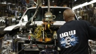 A worker wearing a United Auto Workers (UAW) shirt assembles a Ford Motor Co. Super Duty series pickup truck at the company's truck manufacturing plant in Louisville, Kentucky, U.S.