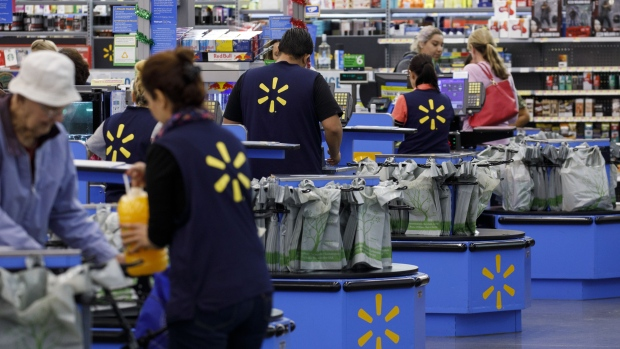 Cashiers ring up shoppers at a Walmart Inc. store in Burbank, California.