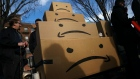 NEW YORK, NY - NOVEMBER 14: Boxes with the Amazon logo turned into a frown face are stacked up after a protest against Amazon in the Long Island City neighborhood of the Queens borough on November 14, 2018 in New York City. Amazon announced on Tuesday that it has chosen Arlington, Virginia and Long Island City as the two new locations which will serve as additional headquarters for the company. Amazon says each location will create 25,000 jobs. (Photo by Drew Angerer/Getty Images)