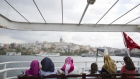 Female passengers look towards the city from the deck of a ferry boat on the Bosporus Strait in Istanbul, Turkey, on Wednesday, July 20, 2016.