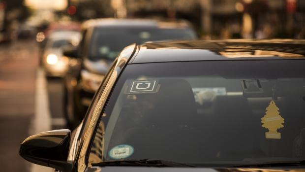 The Uber Technologies Inc. logo is seen on the windshield of a vehicle in New York, U.S.