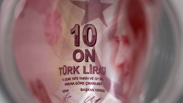 A 10 Turkish Lira banknote sits in this arranged photograph in London, U.K., on Wednesday, Aug. 15, 2018. Turkey took its boldest steps yet to try to ward off a financial crisis by making it harder for traders to bet against the battered lira and easing rules on restructuring troubled loans that have already topped $20 billion.