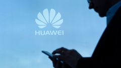 A visitor uses his mobile phone at the Huawei stand on the second day of the Mobile World Congress on February 28, 2017 in Barcelona.