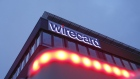 An illuminated logo sits on the exterior of the Wirecard AG headquarters in the Aschheim district of Munich, Germany, on Tuesday, Feb. 12, 2019. Wirecard broke federal securities law by failing to act on an executive's misconduct and misleading investors about it, a complaint filed Feb. 8 in the Central District of California alleges.